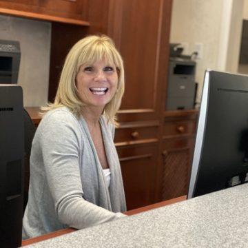 Receptionist at reception desk of Wellesley Dental Arts