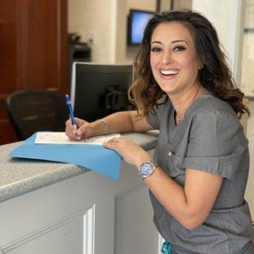 Dr Tania Rohany at Reception's Desk